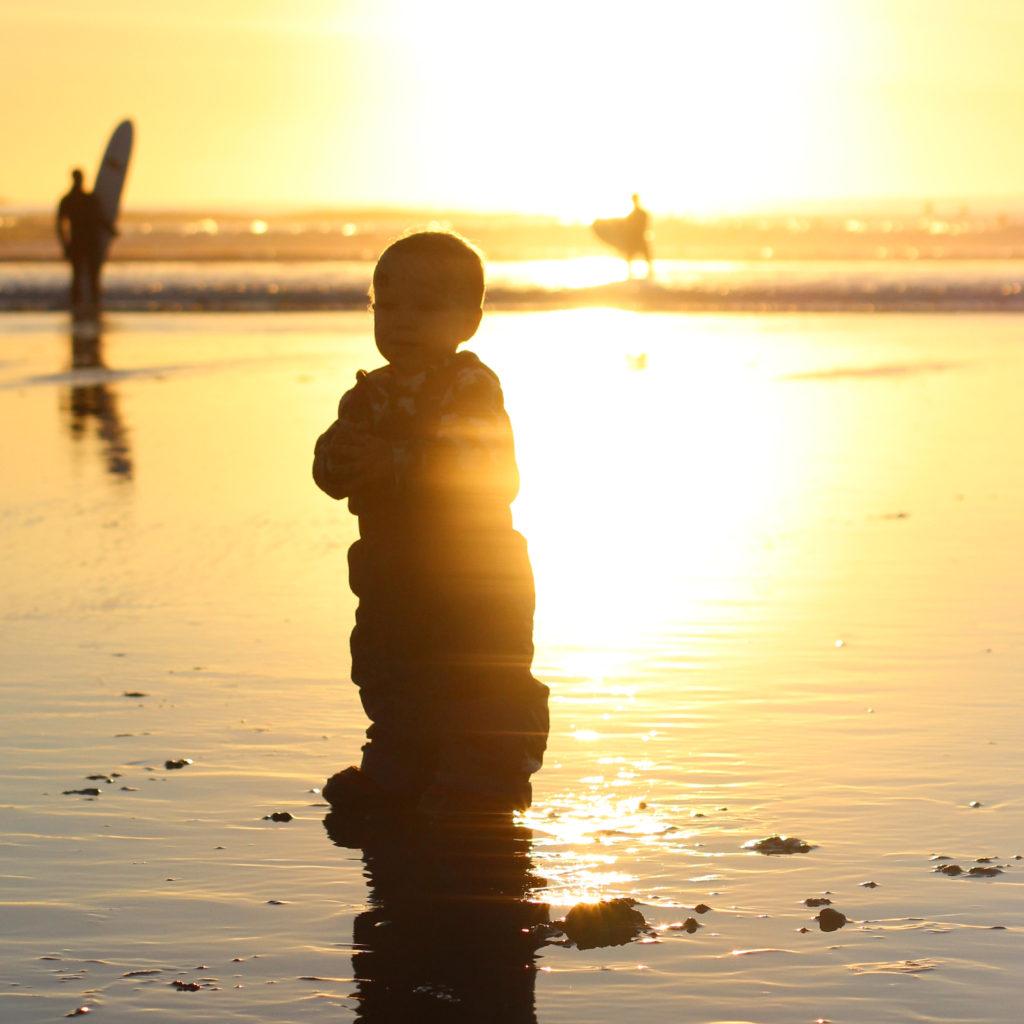 boy at the cox bay beach in Tofino