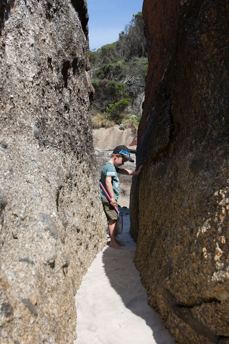 Playing between rocks at Wilsons Promontory National Park Australia