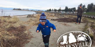 little boy running on parksville beach