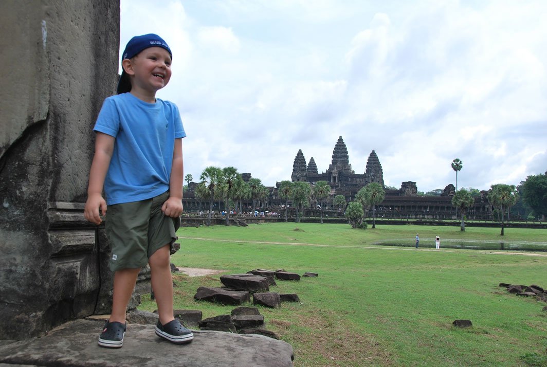 happy travel kid angkor wat temple family adventure cambodia