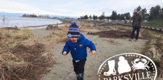 little boy running on parksville beach